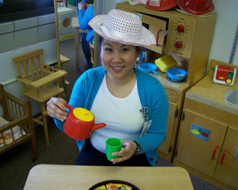 Mrs. Vang enjoying her cup of tea in preschool